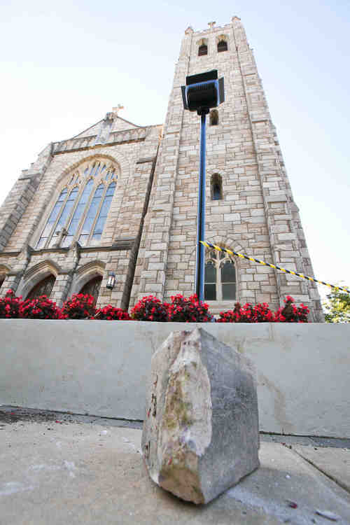 A large chunk of stone that fell off of St. Thomas the Apostle church in Wilmington, Del. are shown Tuesday, Aug. 23, 2011, after one of the strongest earthquakes ever recorded on the East Coast shook buildings and rattled nerves from South Carolina to New England. (AP Photo/The Wilmington News-Journal, Suchat Pederson)  NO SALES
