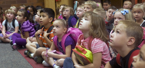 Al Hartmann  |  The Salt Lake Tribune Dual immersion first-graders at Horizon Elementary School in Murray listen how their school year will be split equally with an English speaking teacher and a Spanish speaking teacher on the first day of school Monday August 22.