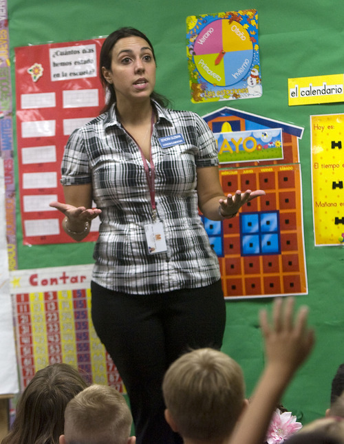 Al Hartmann  |  The Salt Lake Tribune Karina Guzman, first grade teacher at Horizon Elementary in Murray explains to the class on their first day of school that they will only speak Spanish in her class during the school year.     The class is dual immersion.     They spend one half of their classroom experience with Guzman and the other half with Englsh-speaking teacher Linda Curtis.