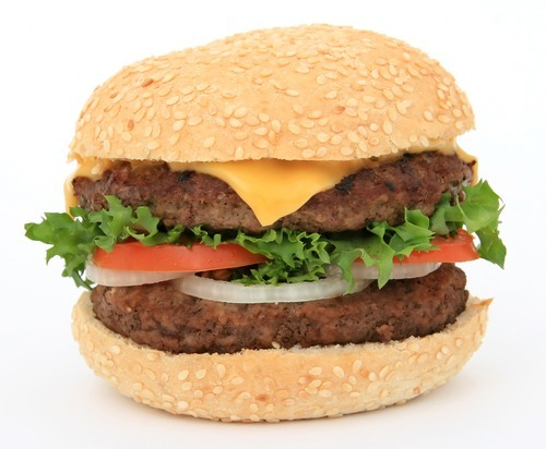 Beef burger in a bun, over white, with lettuce salad, tomato, onion, close up  stock art.