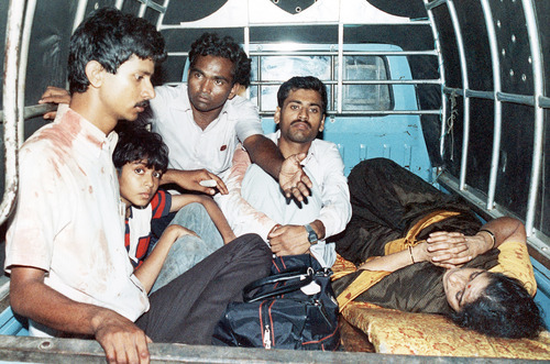 Unidentified passengers from the hijacked Pan Am airliner sit in an official government truck being brought to the local Jinnach hospital for medical treatment in Karachi, Pakistan on Friday, Sept. 6, 1986. The passengers were injured in a shootout in the plane that broke out during a power blackout in the hijacked airliners between Pakistan army commandos and the hijackers. 14 people died in the fight, more than 100 were injured. (AP Photo/Liu Heung Shing)