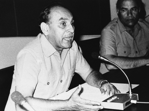 Air Marshal Khurshid Anwar Mirza, director general of Pakistan civil aviation authority explains a point during an impromptu press conference in Karachi, Pakistan after Arab-speaking hijackers stormed the Pan-Am New York-bound flight, Sept. 5, 1986. (AP Photo/Moin Bangsh)