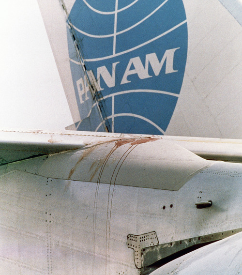 Bloodstain is seen on one of the wings of the Pan Am jetliner on the Karachi Airport, Pakistan on Sept. 6, 1986, more than 24 hours after the bloodbath in the plane after a dramatic end of a hijack. After a shootout between the hijackers and an army commando in the aircraft 14 people died and more than 100 were injured. (AP Photo/Michel Lipchitz)