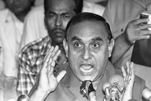 Pakistani air marshal Khurshid Anwar Mirza, who led the negotiations on Friday with the hijackers of the PAN AM jetliner 073, gestures as he answers questions of reporters during an international press conference at the Karachi airport, Pakistan on Sept. 6, 1986. (AP Photo/Heung Shing Liu)