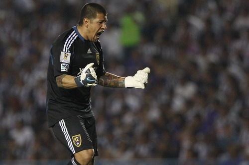 U.S. Real Salt Lake's goalkeeper Tim Melia celebrates after his teammate Javier Morales, not in picture, scored during the Concacaf Champions League first leg final soccer match against Mexico's Monterrey in Monterrey, Mexico, Wednesday, April 20, 2011. The match ended 2-2. (AP Photo/Miguel Tovar)