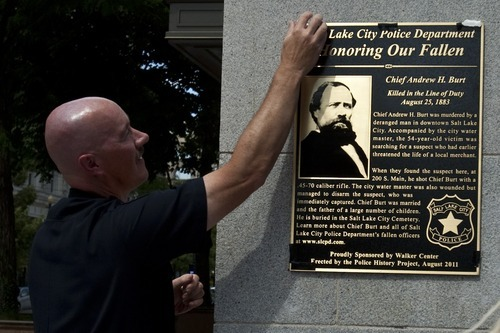 Chris Detrick  |  The Salt Lake Tribune Salt Lake City Police Chief Chris Burbank unveils a bronze plaque memorializing Chief Andrew Burt for the ultimate sacrifice he made while protecting the community 128 years ago. The ceremony took place outside the Walker Center on Main Street in Salt Lake City on Thursday, Aug. 25, 2011.