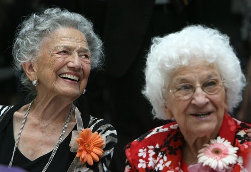Steve Griffin  |  The Salt Lake Tribune  100-year-old Nora Delpiaz and Regina Kloepfer smile as they talk with friends and family during the 25th Annual Centenarians Day celebration at the Multi Agency State Office Building in Salt Lake City, Utah Friday, August 26, 2011.