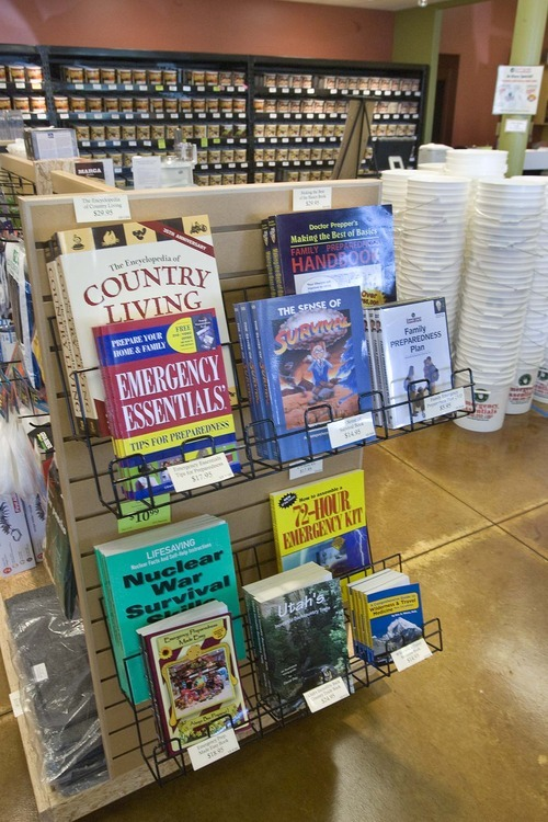 Paul Fraughton  |  The Salt Lake Tribune  Books on survival and emergency preparedness on the shelves at Emergency Essentials in South Jordan.