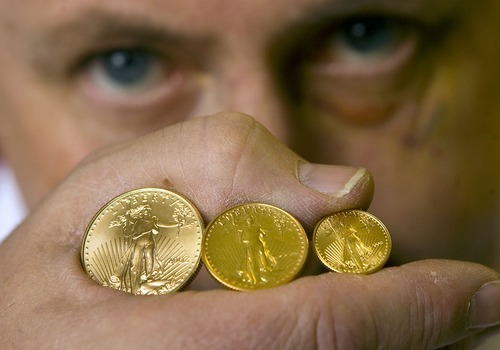 Al Hartmann  |   Salt Lake Tribune  Bob Campbell at All About Coins, in Salt Lake City, has a hard time keeping up with demand for Golden Eagle coins. He holds 1/2 -ounce, left, 1/4-ounce and 1/10-ounce  Golden Eagle coins. Gold prices are at an all-time high and silver prices are soaring as well.
