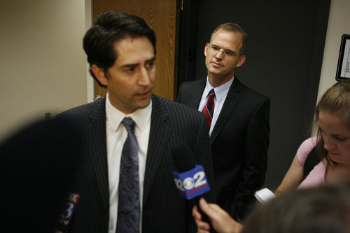 Francisco Kjolseth  |  The Salt Lake Tribune Former U.S. Attorney Brett Tolman, left, speaks to the media on behalf of Provo Councilman Steve Turley after Turley made his first appearance in 4th District Court in Provo, on fraud counts, on Wednesday, Aug. 24, 2011.