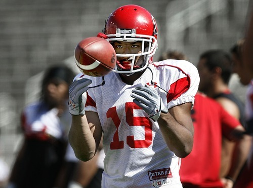 Scott Sommerdorf  |  The Salt Lake Tribune RB John White IV (15), flips the ball around while waiting for his turn at a drill during a scrimmage held at Rice-Eccles Stadium Thursday, August 11, 2011.
