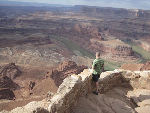 Tom Wharton  |  The Salt Lake Tribune A tourist enjoys the view from Dead Horse Point State Park near Moab.