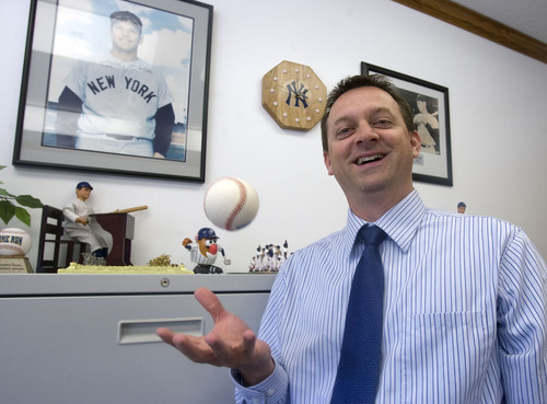 Al Hartmann  |  The Salt Lake Tribune Robert McDaniel has been named Murray School District's new assistant superintendent. He is a serious Yankee baseball fan, tossing a 1999 World Series ball in his office.