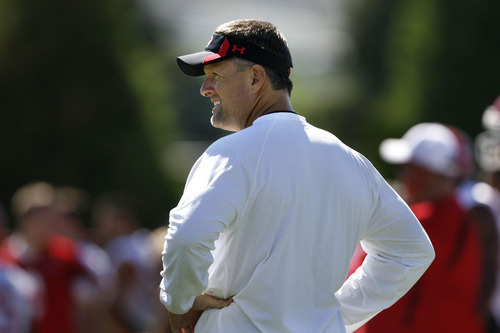 Scott Sommerdorf  |  The Salt Lake Tribune Utah head coach Kyle Whittingham watches his team practice on Aug. 4.