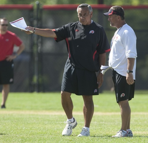 Chris Detrick  |  The Salt Lake Tribune Utah Ute offensive coordinator Norm Chow and Utah Ute coach Kyle Whittingham talk during practice at the University of Utah Thursday August 18, 2011.