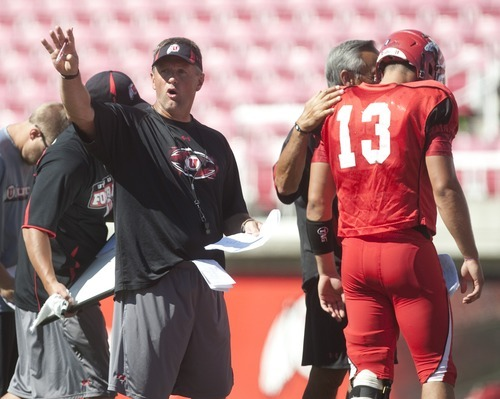 Chris Detrick     The Salt Lake Tribune Kyle Whittingham calls out plays during a practice at Rice-Eccles Stadium Wednesday August 17, 2011.
