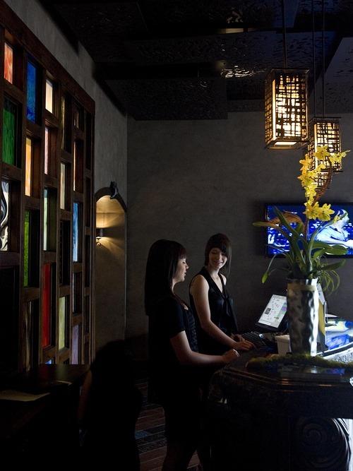 Djamila Grossman  |  The Salt Lake Tribune  Hosts Holly Hubbard and Riley Bingham welcome people at Vuz Restaurant in Draper.
