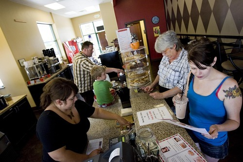 Djamila Grossman  |  The Salt Lake Tribune  Keslie and Tim Lyons and their son, Max, 3, make drinks for Katie and Joan Bills at their coffee shop, the Dancing Yeti Coffee, in Draper on Wednesday, Aug. 31, 2011. The couple sold around 100 gift certificates on CityDeals.com but they have not been paid. The company's website was disabled Wednesday.