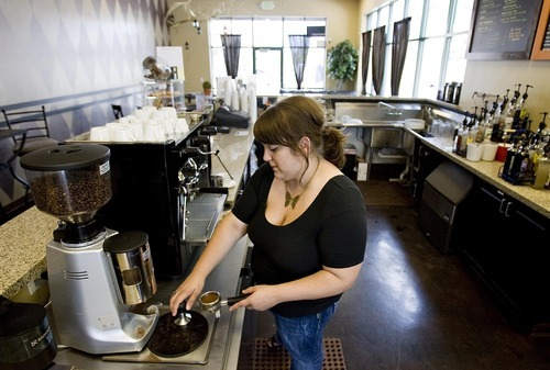 Djamila Grossman  |  The Salt Lake Tribune  Keslie Lyons grinds coffee beans at her coffee shop, the Dancing Yeti Coffee, in Draper on Wednesday, Aug. 31, 2011. Lyons and her husband, Tim Lyons, sold around 100 gift certificates on CityDeals.com but they have not been paid. The company's website was disabled Wednesday.