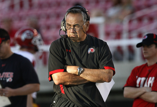 Scott Sommerdorf  |  The Salt Lake Tribune Utah Offensvie Coordinator Norm Chow watches the offense go through it's paces during Spring practice. The Utes scrimmaged Friday night, April 1st, 2011 at Rice Eccles Stadium.