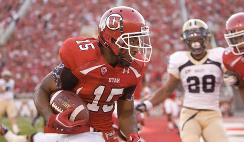 Trent Nelson  |  The Salt Lake Tribune  Utah Utes running back John White IV (15) scores a touchdown in the first quarter as Utah takes on Montana State at Rice-Eccles Stadium Thursday, Sept. 1, 2011.