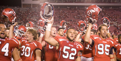 Trent Nelson  |  The Salt Lake Tribune  Utah players celebrate at the end of the first game as Utah takes on Montana State at Rice-Eccles Stadium Thursday, Sept. 1, 2011.