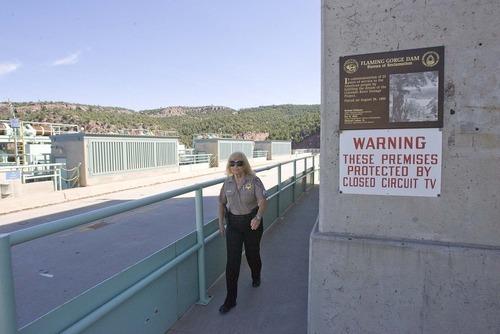 Paul Fraughton  |  The Salt Lake Tribune Sgt. Cher Maras makes her security rounds at the dam on Thursday, Aug. 18, 2011.