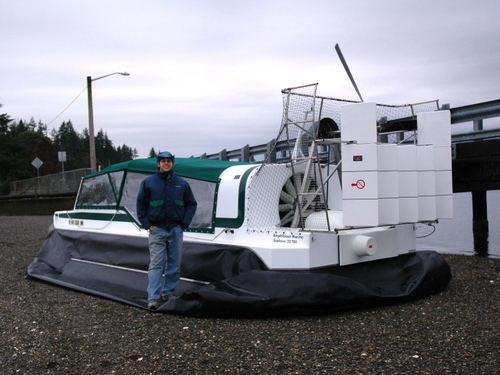 Bryan Phillips stands beside a hovercraft. Daggett County is awaiting the arrival of a hovercraft it purchased with a $100,000 grant from the U.S. Department of Homeland Security. This photograph shows an example of the craft, which is still under construction and is expected to arrive in Daggett County in December. Photo courtesy Amphibious Marine.