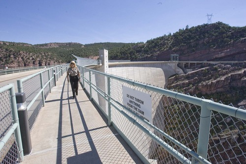 Paul Fraughton  |  The Salt Lake Tribune Sgt. Cher Maras makes her security rounds at the Flaming Gorge Dam along the walkway, which is now off limits to anyone who is not on the official tour.