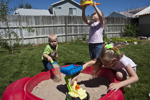 Chris Detrick | The Salt Lake Tribune  Clint and Coralie Seright's kids Britney, 6, Brooklyn, 4, and Hunter, 1, play at their home Wednesday, July 20, 2011.