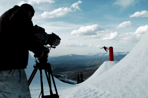 In this May 8, 2011 photo, a cameraman uses a Phantom camera to film the snowboarding documentary