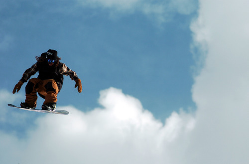 In this May 8, 2011 photo, professional snowboarder Danny Davis catches some air during the filming of