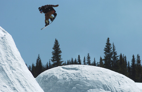 In this May 8, 2011 photo, professional snowboarder Danny Davis negotiates his way through