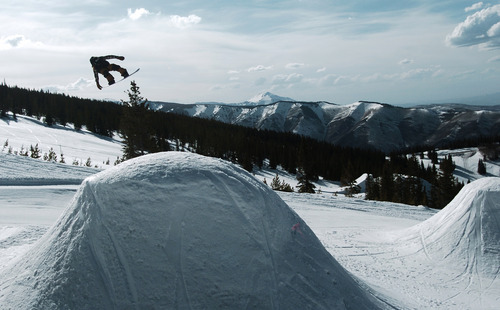In this May 8, 2011 photo, professional snowboarder Danny Davis catches some air during the filming of the documentary