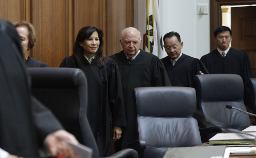 From left to right, California Supreme Court Justices, Joyce Kennard, Tani Cantil-Sakauye, Marvin Baxter, Ming Chin and Goodwin Liu, enter a courtroom during a California State Supreme Court hearing in San Francisco on Tuesday, Sept. 6, 2011. On Tuesday, the California Supreme Court will be considering whether the sponsors of Proposition 8 have a legal right to appeal the federal court ruling that overturned the same-sex marriage ban, since the governor and attorney general refused to bring such an appeal. The 9th US District Court of Appeals, which has main responsibility for the case on appeal, asked the state court to weigh in on the question it deals with the state's ballot initiative process. (AP Photo/Paul Sakuma)