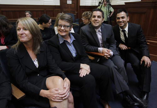 From left to right, plaintiffs same-sex couples Sandra Stier and partner Kristin Perry, and Jeffrey Zarrillo and partner Paul Katami smile in a courtroom before the California State Supreme Court hearing in San Francisco on Tuesday, Sept. 6, 2011. On Tuesday, the California Supreme Court will be considering whether the sponsors of Proposition 8 have a legal right to appeal the federal court ruling that overturned the same-sex marriage ban, since the governor and attorney general refused to bring such an appeal. The 9th US District Court of Appeals, which has main responsibility for the case on appeal, asked the state court to weigh in on the question it deals with the state's ballot initiative process. (AP Photo/Paul Sakuma)