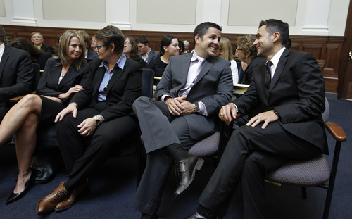 From left to right, plaintiffs same-sex couples Sandra Stier and partner Kristin Perry, and Jeffrey Zarrillo and partner Paul Katami smile in a courtroom before the California State Supreme Court hearing in San Francisco on Tuesday Sept. 6, 2011. On Tuesday, the California Supreme Court will be considering whether the sponsors of Proposition 8 have a legal right to appeal the federal court ruling that overturned the same-sex marriage ban, since the governor and attorney general refused to bring such an appeal. The 9th US District Court of Appeals, which has main responsibility for the case on appeal, asked the state court to weigh in on the question it deals with the state's ballot initiative process. (AP Photo/Paul Sakuma)