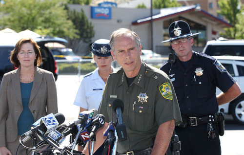 Carson City Sheriff Ken Furlong, center, holds a press conference outside the IHOP restaurant in Carson City, Nev., on Tuesday, Sept. 6, 2011, after a gunman opened fire with an AK-47, killing three and injuring six. From left, IHOP President Jean Birch, Nevada National Guard Maj. April Conway, and Nevada Highway Patrol Trooper Chuck Allen also spoke at the press conference. (AP Photo/Cathleen Allison)