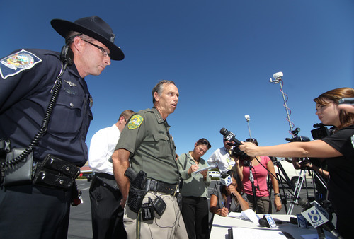 Carson City Sheriff Ken Furlong, center, and Trooper Chuck Allen, answer media questions following a shooting in an IHOP restaurant in Carson City, Nev., on Tuesday, Sept. 6, 2011.  A gunman with a rifle opened fire at a International House of Pancakes restaurantkilling three people including two uniformed National Guard members and himself, and wounding six others in a hail of gunfire during the morning breakfast hour, authorities and witnesses said.   (AP Photo/Cathleen Allison)
