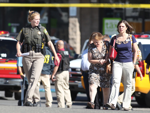 Emergency personnel respond to a shooting at an IHOP restaurant in Carson City, Nev., on Tuesday, Sept. 6, 2011. Three people were killed after a gunman opened fire at the restaurant, authorities said. (AP Photo/Cathleen Allison)