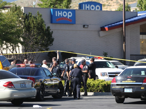 Emergency personnel respond to a shooting at an IHOP restaurant in Carson City, Nev. on Tuesday, Sept., 6, 2011. Three people were killed after a gunman opened fire at the restaurant, authorities said. (AP Photo/Cathleen Allison)