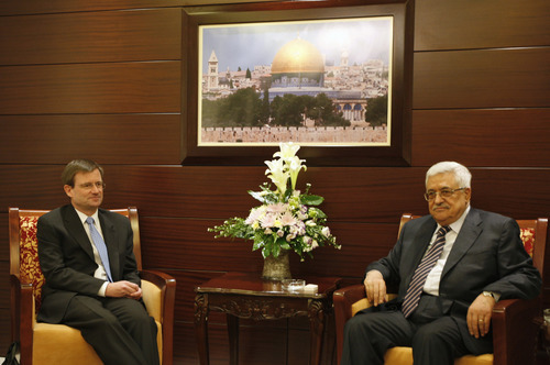 Senior White House envoy David Hale, left, sits with Palestinian President Mahmoud Abbas during their meeting at Abbas's headquarters in the West Bank city of Ramallah, Wednesday, Sept. 7, 2011. The Palestinians on Tuesday said they would not give in to American pressure to drop their bid for statehood at the United Nations, taking a tough position ahead of a meeting with Hale and Dennis Ross. (AP Photo/Majdi Mohammed)