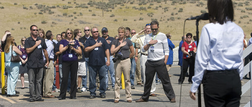 Al Hartmann  |  The Salt Lake Tribune  ATK test fires a DM-3 rocket motor at ATK's  Promontory facility west of Brigham City Thursday September 8 at 2 p.m.  Guests of NASA and ATK listen to the National Anthem prior to firing of the rocket motor.