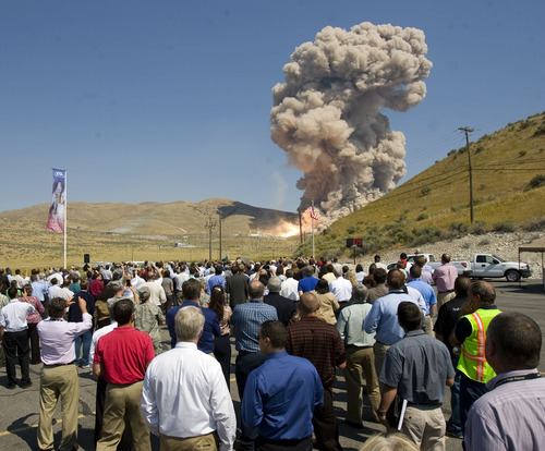 Al Hartmann  |  The Salt Lake Tribune  Guest and employees of ATK and Nasa gather at  the Promontory facility west of Brigham City Thursday September 8  to watch ATK test fire a DM-3 rocket motor.