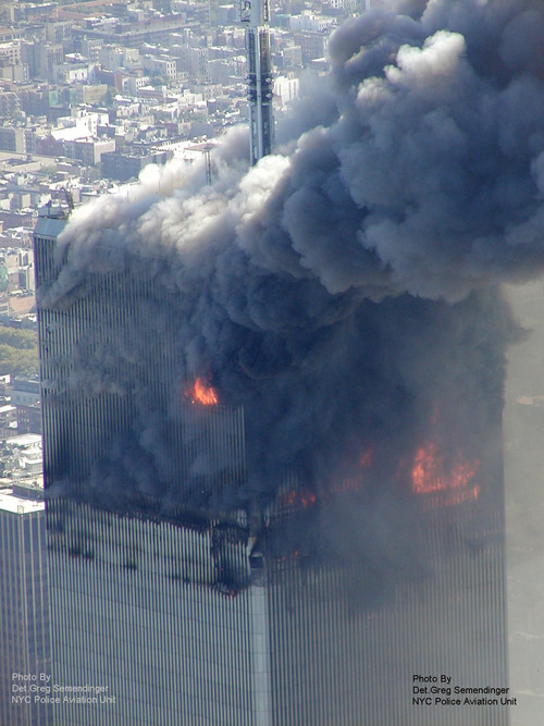 This photo taken Sept. 11, 2001 by the New York City Police Department and obtained by ABC News, which claims to have obtained it under the Freedom of Information Act, shows smoke billowing from one of the towers of the World Trade Center in New York. (AP Photo/NYPD via ABC News, Det. Greg Semendinger)