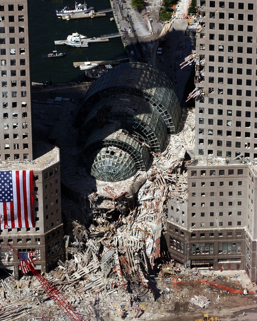 An aerial view on Sept. 17 2001, shows the debris-clogged Winter Garden between the buildings of the World Financial Center near the World Trade Center which collapsed following the Sept. 11 terrorist attack. These surrounding buildings were heavily damaged by the debris and massive force of the falling twin towers. Clean-up efforts are expected to continue for months.  (AP Photo/U.S. Navy, Chief Photographer's Mate Eric J. Tilford)