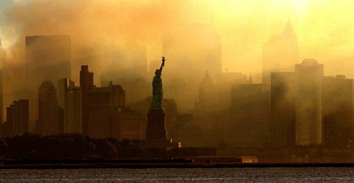 The Statue of Liberty is seen at first light in this view from Jersey City, N.J., against a smoke-filled backdrop of the lower Manhattan skyline, early Saturday, Sept. 15, 2001.   (Dan Loh/The Associated Press)