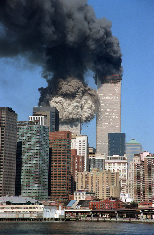 The south tower collapses as smoke billows from both towers of the World Trade Center, in New York, Tuesday, Sept. 11, 2001. In one of the most horrifying attacks ever against the United States, terrorists crashed two airliners into the World Trade Center in a deadly series of blows that brought down the twin 110-story towers. (Jim Collins/The Associated Press)