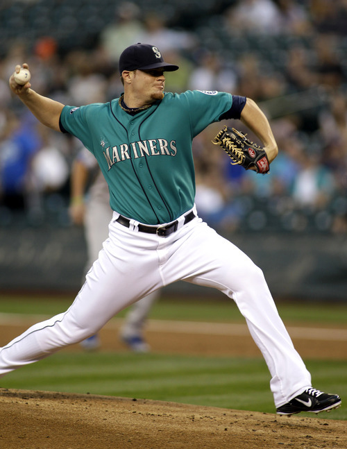 Seattle Mariners starting pitcher Blake Beavan throws against the Kansas City Royals in the first inning of a baseball game, Friday, Sept. 9, 2011, in Seattle. (AP Photo/Ted S. Warren)