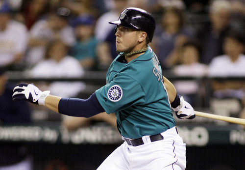 Seattle Mariners' Justin Smoak hits an RBI single in the fifth inning of a baseball game against the Kansas City Royals, Friday, Sept. 9, 2011, in Seattle. (AP Photo/Ted S. Warren)